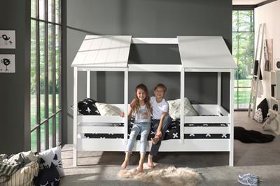 Huisbed met wit dak met opening midden in gebruik